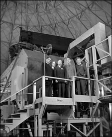 Tennessee Eastman officials and General Leslie R. Groves with Lawrence at the magnet for the 184-inch cyclotron