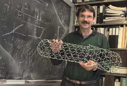 Alex Zettl with a model of a carbon nanotube